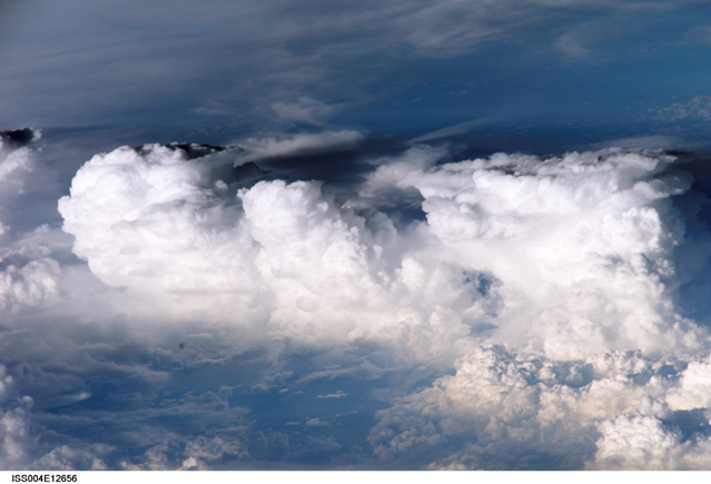 A cluster of towering cumulus clouds off the coast of El Salvador. This photograph was taken on May 31, 2002, from the International Space Station. Image courtesy of the Earth Science and Remote Sensing Unit, NASA Johnson Space Center, at http://eol.jsc.nasa.gov [Photo ID ISS004-E-12656]